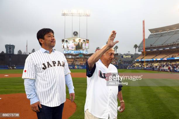 Hideo Nomo and Tommy Lasorda throw out the ceremonial first pitch before Game 2 of the Championship Round of the 2017 World Baseball Classic between...