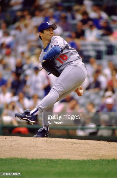 Hideo Nomo of the Los Angeles Dodgers pitches during an MLB game at Wrigley Field in Chicago, Illinois. Nomo played for 12 seasons with 7 different...