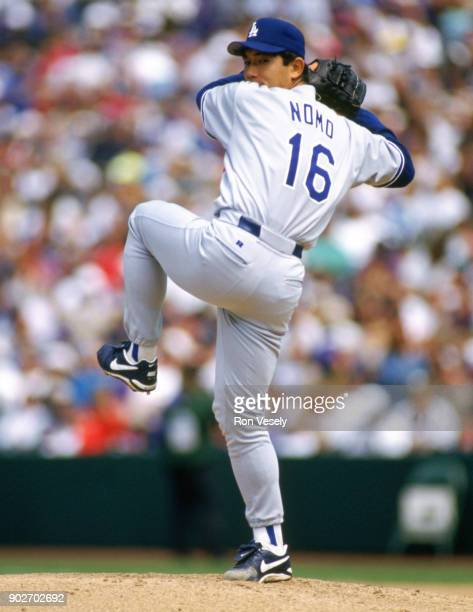 Hideo Noms of the Los Angeles Dodgers pitches during an MLB game versus the Colorado Rockies at Coors Field in Denver, Colorado during the 1995...