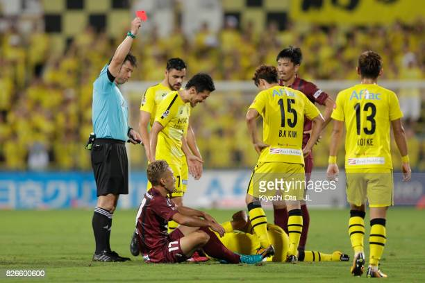Hideo Tanaka of Vissel Kobe is shown a red card by referee Yoshiro Imamura during the JLeague J1 match between Kashiwa Reysol and Vissel Kobe at...