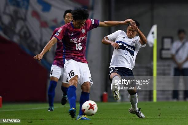 Hideto Takahashi of Vissel Kobe and Takuya Kida of Yokohama FMarinos compete for the ball during the JLeague match between Vissel Kobe and Yokohama...