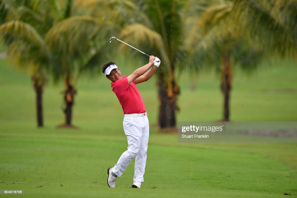 Hideto Tanihara of Asia hits an approach shot during the fourballs matches on day one of the 2018 EurAsia Cup presented by DRB-HICOM at Glenmarie G&CC on January 12, 2018 in Kuala Lumpur, Malaysia.