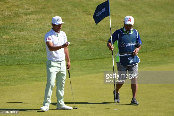 Hideto Tanihara of Japan acknowledges the crowd on the 16th green during day three of the Dubai Duty Free Irish Open at Portstewart Golf Club on July...