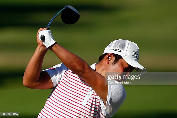 Hideto Tanihara of Japan hits a shot on the first tee during the third round of the Sony Open in Hawaii at Waialae Country Club on January 11 2014 in...