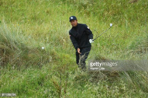 Hideto Tanihara of Japan hits his second shot on the 8th hole during the final round of the Dubai Duty Free Irish Open at Portstewart Golf Club on...