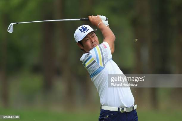 Hideto Tanihara of Japan hits his second shot on the 9th hole during day four of the BMW PGA Championship at Wentworth on May 28 2017 in Virginia...