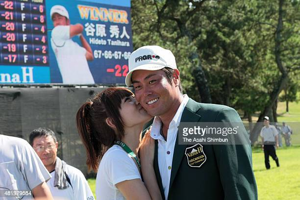 Hideto Tanihara of Japan is kissed by his wife Ayaka after winning the Vana H Cup KBC Augusta at Keya Golf Club on August 26 2010 in Itoshima Fukuoka...