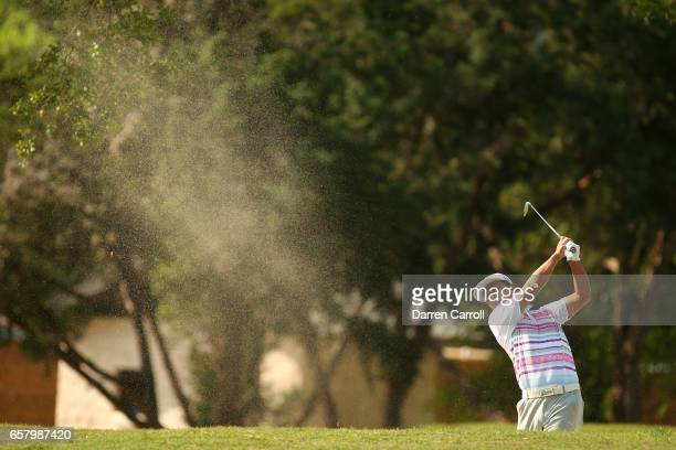 Hideto Tanihara of Japan plays a shot out of a bunker on the 6th hole of his match during the semifinals of the World Golf ChampionshipsDell...