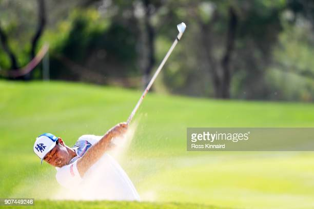 Hideto Tanihara of Japan plays his fourth shot on the 13th hole during round three of the Abu Dhabi HSBC Golf Championship at Abu Dhabi Golf Club on...