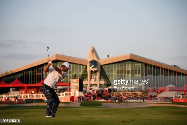 Hideto Tanihara of Japan plays his second shot on the ninth hole during round one of the Abu Dhabi HSBC Golf Championship at Abu Dhabi Golf Club on...