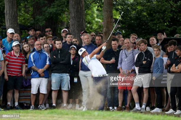 Hideto Tanihara of Japan plays his second shot to the par 4 15th hole during the final round of the 2017 BMW PGA Championship on the West Course at...