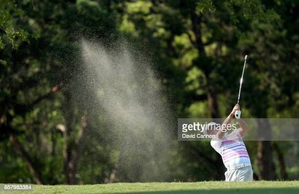 Hideto Tanihara of Japan plays his seocnd shot on teh par 5 sixth hole in his match against Dustin Johnson during the semifinal of the 2017 Dell...