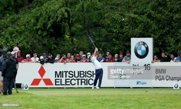 Hideto Tanihara of Japan plays his tee shot to the par 4 16th hole during the final round of the 2017 BMW PGA Championship on the West Course at...