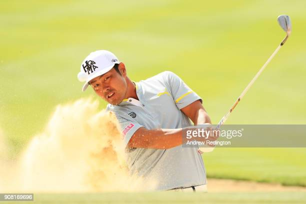 Hideto Tanihara of Japan plays his third shot from a bunker on the 17th hole during the final round of the Abu Dhabi HSBC Golf Championship at Abu...
