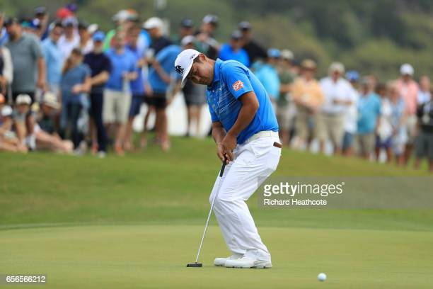 Hideto Tanihara of Japan putts on the 15th hole of his match during round one of the World Golf ChampionshipsDell Technologies Match Play at the...
