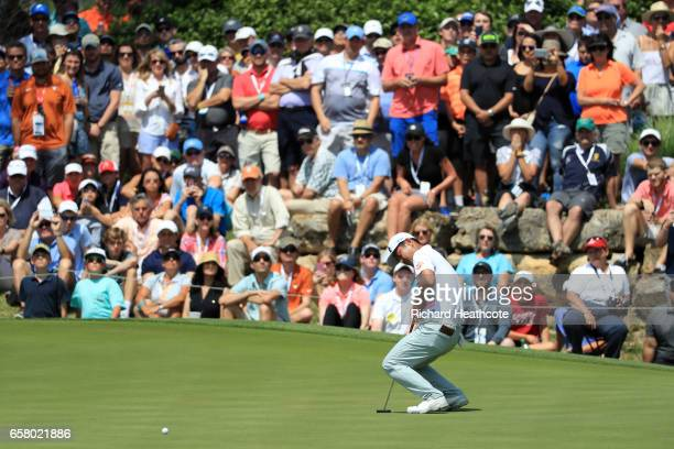 Hideto Tanihara of Japan reacts after putting on the 18th hole of his match during the semifinals of the World Golf ChampionshipsDell Technologies...