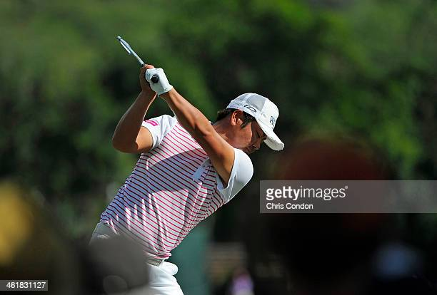 Hideto Tanihara of Japan tees off on the 4th hole during the third round of the Sony Open in Hawaii at Waialae Country Club on January 11 2014 in...