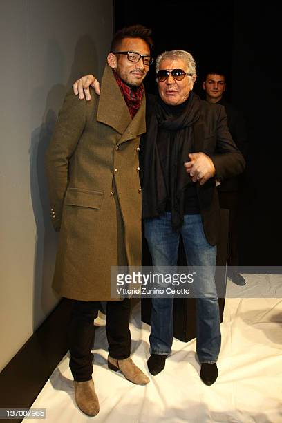 Hidetoshi Nakata and designer Roberto Cavalli attend the Roberto Cavalli fashion show as part of Milan Fashion Week Menswear Autumn/Winter 2012 on...