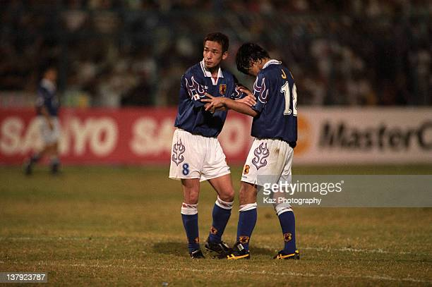 Hidetoshi Nakata and Shoji Jo are seen during the 1998 France World Cup Asian Playoff match between Japan and Iran at Larkin Stadium on November 16...