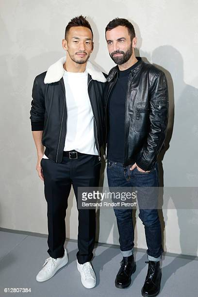 Hidetoshi Nakata and Stylist Nicolas Ghesquiere pose after the Louis Vuitton show as part of the Paris Fashion Week Womenswear Spring/Summer 2017 on...