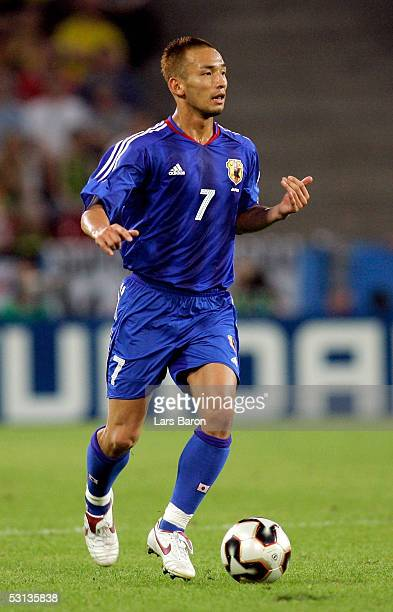 Hidetoshi Nakata from Japan gestures as he runs with the ball during the match between Japan and Brazil for the Confederations Cup 2005 on June 22...
