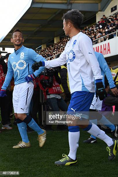 Hidetoshi Nakata of J Amigos chats with Kazuyoshi Miura of Yokohama Friends during the Daisuke Oku Memorial Match between J Amigos and Yokohama...