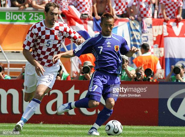 Hidetoshi Nakata of Japan and Igor Tudor of Croatia compete for the ball during the FIFA World Cup Germany 2006 Group F match between Japan and...