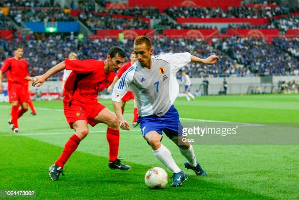 Hidetoshi Nakata of Japan and Jacky Peeters of Belgium during the World Cup match between Japan and Belgium in Saitama Stadium in Saitama Japan on...