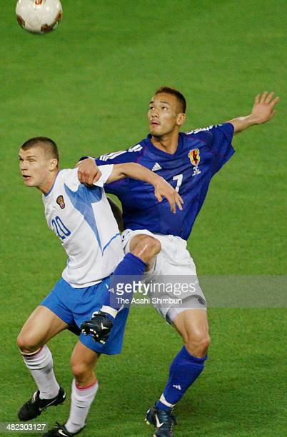 Hidetoshi Nakata of Japan and Marat Izmailov of Russia compete for the ball during the FIFA World Cup Korea/Japan Group H match between Japan and...