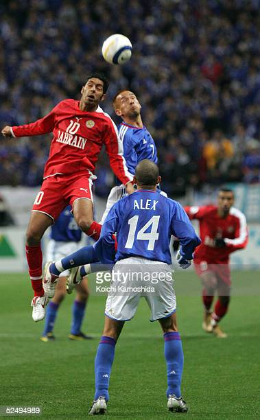 Hidetoshi Nakata of Japan and Mohamed Ahmed Salmeen of Bahrain chalenge for the ball during the 2006 FIFA World Cup Asian qualifying match between...