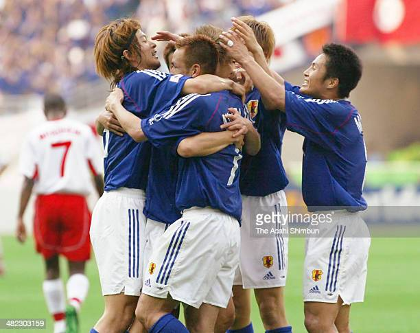 Hidetoshi Nakata of Japan celebrates scoring his team's second goal with his teammates during the FIFA World Cup Korea/Japan Group H match between...