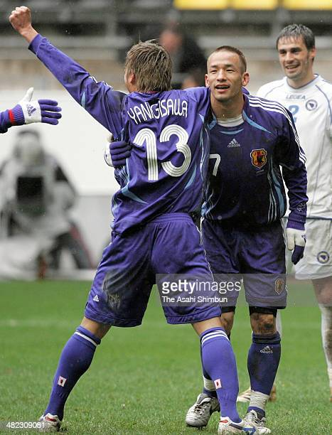 Hidetoshi Nakata of Japan celebrates scoring his team's second goal with his teammates Atsushi Yanagisawa during the international friendly match...
