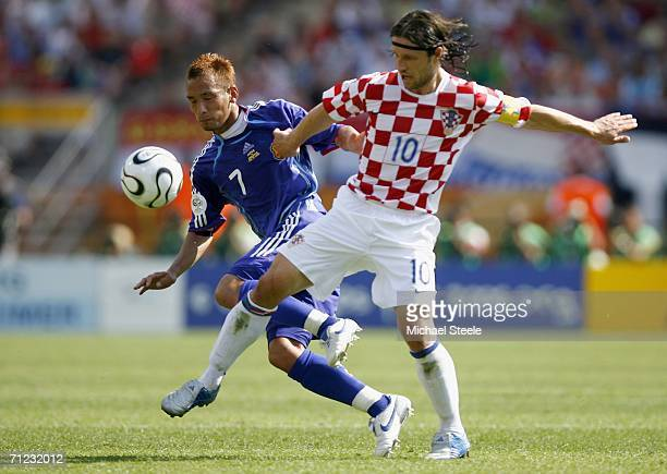 Hidetoshi Nakata of Japan competes for the ball with Niko Kovac of Croatia during the FIFA World Cup Germany 2006 Group F match between Japan and...