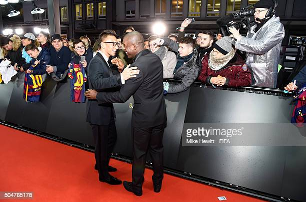 Hidetoshi Nakata of Japan greets Clarence Seedorf of the Netherlands as they arrive for the FIFA Ballon d'Or Gala 2015 at the Kongresshaus on January...