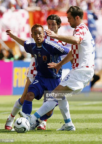 Hidetoshi Nakata of Japan is tackled by Igor Tudor of Croatia during the FIFA World Cup Germany 2006 Group F match between Japan and Croatia at the...