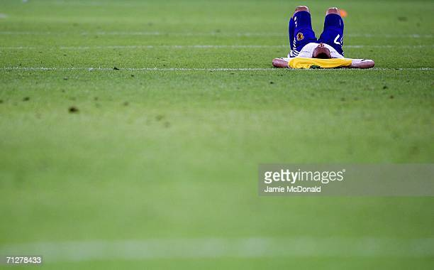 Hidetoshi Nakata of Japan lies dejected after losing to Brazil during the FIFA World Cup Germany 2006 Group F match between Japan and Brazil at the...