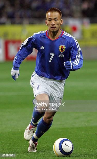 Hidetoshi Nakata of Japan runs with the ball during the 2006 FIFA World Cup Asian qualifying match between Japan and Bahrain at Saitama Stadium on...