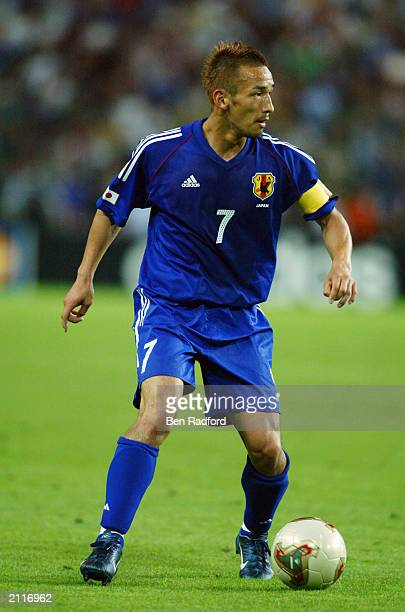 Hidetoshi Nakata of Japan runs with the ball during the FIFA Confederations Cup Group A match between France and Japan held on June 20 2003 at the...