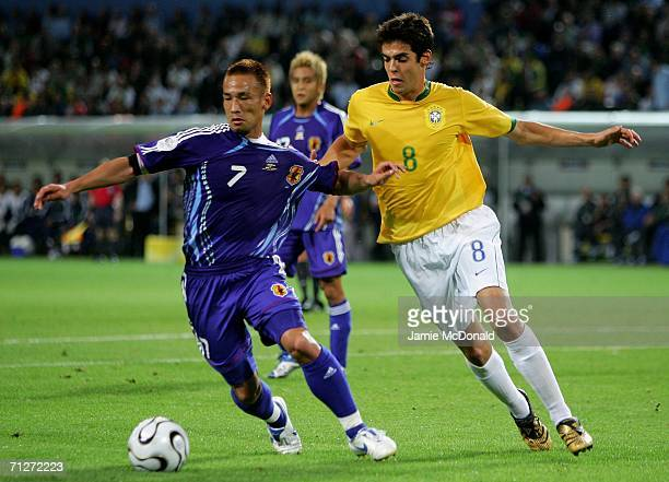 Hidetoshi Nakata of Japan tries to tackle Kaka of Brazil during the FIFA World Cup Germany 2006 Group F match between Japan and Brazil at the Stadium...