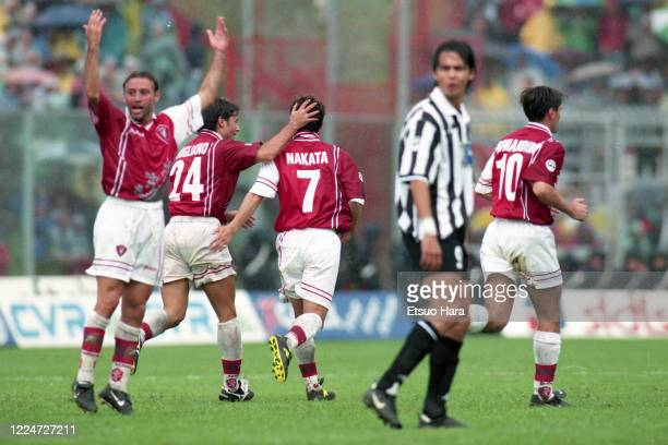 Hidetoshi Nakata of Perugia celebrates scoring his side's second goal with his team mate during the Serie A match between Perugia and Juventus at the...