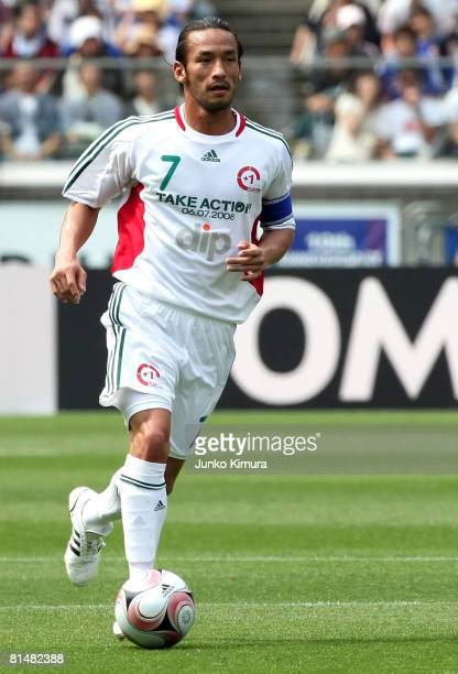 Hidetoshi Nakata of the Japan Stars Team controls the ball during the 1 football match between Japan Stars and World Stars at Nissan Stadium on June...