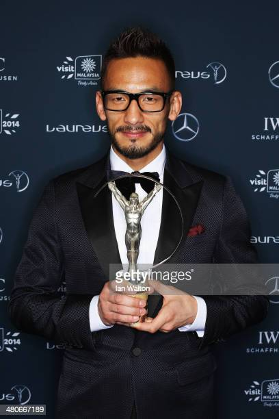 Hidetoshi Nakata poses with the trophy during the 2014 Laureus World Sports Awards at the Istana Budaya Theatre on March 26 2014 in Kuala Lumpur...