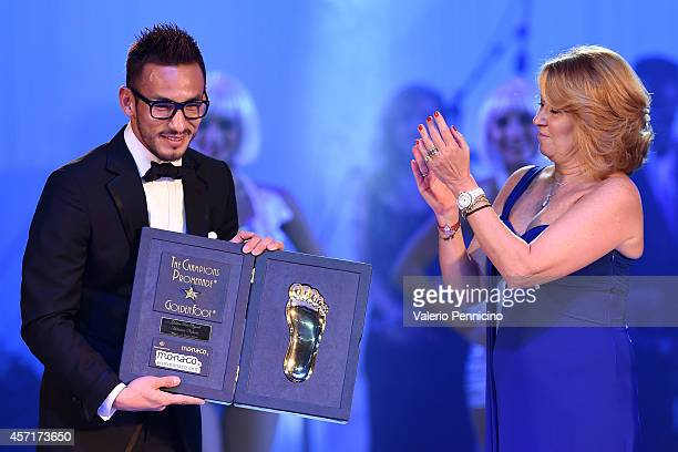 Hidetoshi Nakata receives the Golden Foot Award trophy during the Golden Foot Award 2014 ceremony at Sporting Club on October 13 2014 in MonteCarlo...