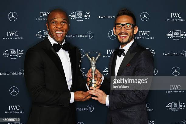 Hidetoshi Nakata with Quinton Fortune hold the Laureus trophy during the 2014 Laureus World Sports Awards at the Istana Budaya Theatre on March 26...