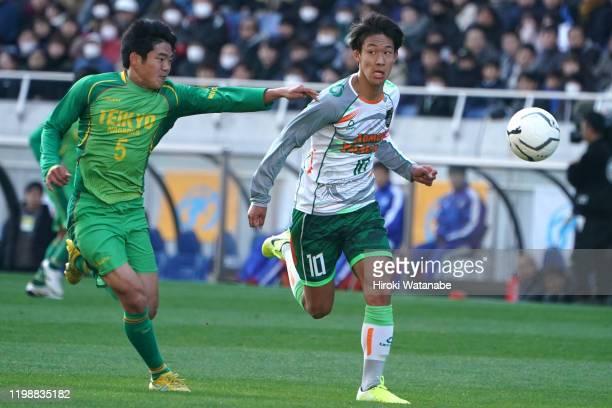 Hidetoshi Takeda of Aomori Yamada and Kyota Maruyama of Teikyo Nagaoka compete for the ball during the 98th All Japan High School Soccer Tournament...