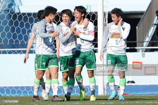 Hidetoshi Takeda of Aomori Yamada cerebrates scoring his team's third goal during the 98th All Japan High School Soccer Tournament quarter final...