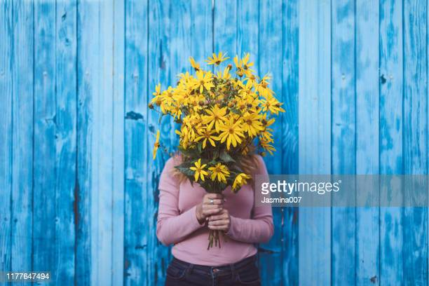hiding behind the flowers - flower head stock pictures, royalty-free photos & images