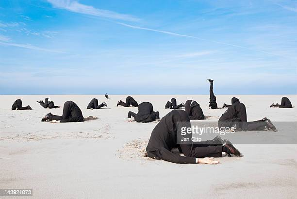 hiding head in sand - escapism stock photos and pictures