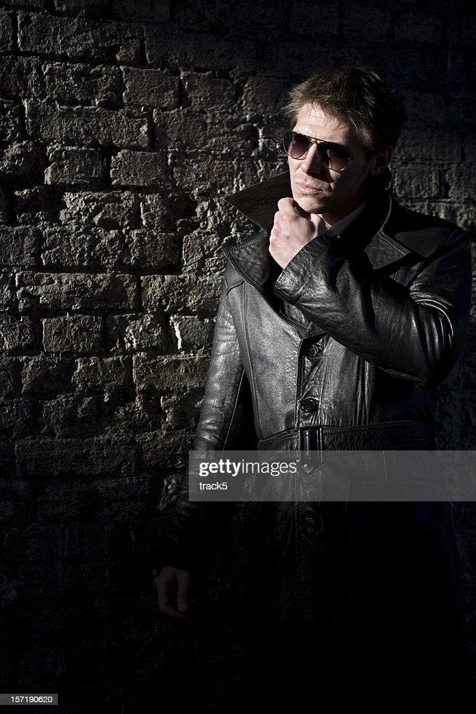 hiding in the shadows : Stock Photo