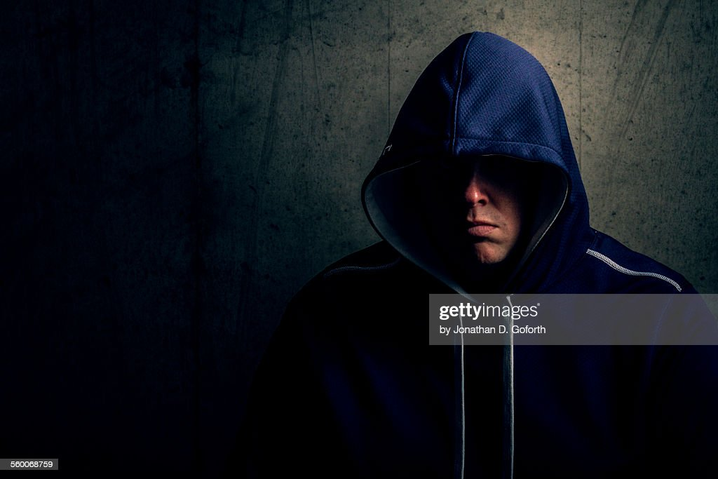 Hiding in the shadows : Stock Photo
